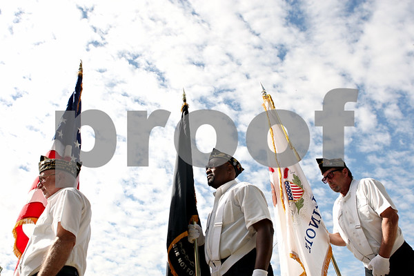 Rob Winner – rwinner@daily-chronicle.com<br /> <br /> Members of the color guard including (from left) George Murphy, Casey White, and Bob Scholl, of Sandwich VFW Post 1486, prepare to present the flags before the Talk of the Town band performs at the Ag Land Stage at the Sandwich Fair in Sandwich, Ill. on Friday September 10, 2010.