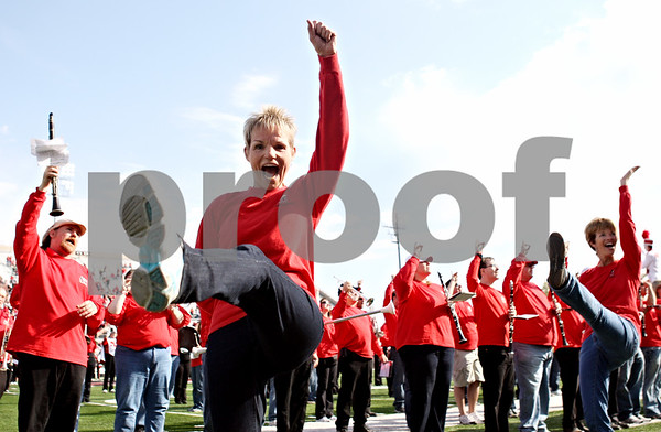 Rob Winner – rwinner@daily-chronicle.com<br /> <br /> Northern Illinois alumnus Joy Nelson, of Geneva, participates with a baton on the field of Huskie Stadium with fellow alumni before the start of Saturday's homecoming game in DeKalb, Ill. on Saturday October 16, 2010.