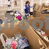 Kyle Bursaw – kbursaw@daily-chronicle.com<br /> <br /> Eileen McCloskey sorts out all the non-clothing donations into several large boxes in the back of the Goodwill in DeKalb, Ill. on Wednesday, Dec. 15, 2010.