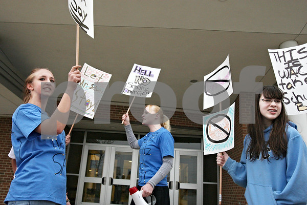 Rob Winner – rwinner@daily-chronicle.com<br /> <br /> On Tuesday April 6, 2010 in Hinckley, Ill., Hinckley-Big Rock students including Cheyenne Janssen (from left), Harmoni Vincent, and Nicole Hayes protest the firing of math and science teacher Bud Schultz.