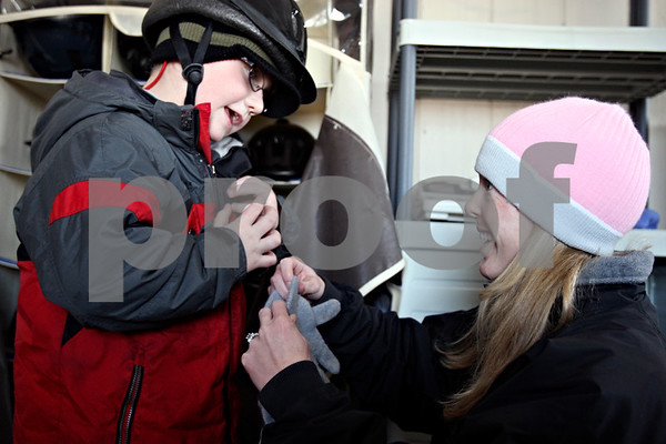 Rob Winner – rwinner@daily-chronicle.com<br /> Jeremiah Diehl, 5 of Elgin, prepares for a hippotherapy session at Blazing Prairie Stars in Maple Park, Ill. with occupational therapist Kelly Marie Christiansen on Wednesday January 13, 2010.