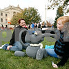 Rob Winner – rwinner@daily-chronicle.com<br /> <br /> Sycamore resident Miranda Doty (right), 12, and her morther, Christina Doty, touch-up Miranda's pumpkin entry at the first day of the Pumpkin Festival in downtown Sycamore, Ill. on October 27, 2010.