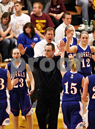 Beck Diefenbach  -  bdiefenbach@daily-chronicle.com<br /> <br /> Hinckley-Big Rock head coach Greg Burks welcomes his team back for a timeout during the first quarter of the IHSA Class 1A Super Sectional championship game against Stockton at Judson University in Elgin, Ill., on Monday Feb. 22, 2010.