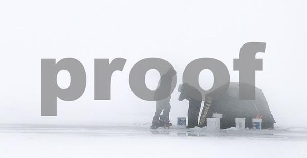 Kyle Bursaw – kbursaw@daily-chronicle.com<br /> <br /> A pair ice fish in the distance on a foggy day on Shabbona Lake on Thursday, Dec. 30, 2010.