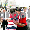 "Rob Winner – rwinner@daily-chronicle.com<br /> <br /> Commander Jerry ""Jug"" Johnson, of VFW Post 2287, hugs his sister, Cherry Potts, while handing out flags during a Memorial Day parade heading west on Lincoln Highway on Monday May 31, 2010 in DeKalb, Ill."