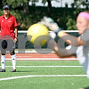 Rob Winner – rwinner@daily-chronicle.com<br /> <br /> Northern Illinois University women's soccer coach Carrie Barker watches as NIU goalkeeper Meaghan Bennett makes a save during a college prospect soccer camp on Tuesday July 13, 2010 in DeKalb, Ill. Barker recently went to Uganda to help train 182 Ugandan soccer coaches.