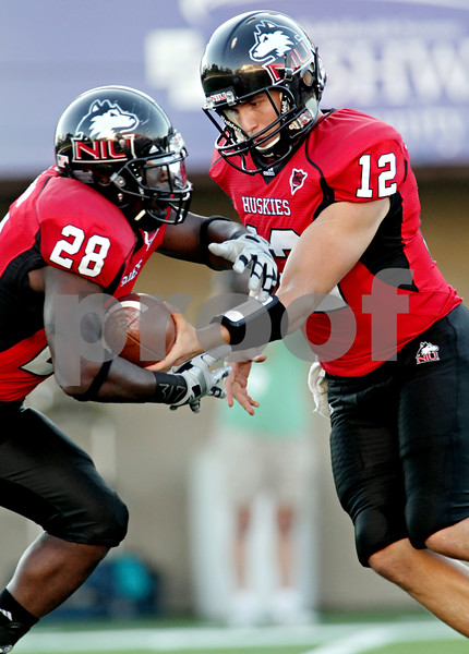 Rob Winner – rwinner@daily-chronicle.com<br /> <br /> Northern Illinois running back Chad Spann receives a hand off from Chandler Harnish on the first play from scrimmage during the first quarter in DeKalb, Ill. on Saturday September 11, 2010. Spann would score Northern's first touchdown on the run. Northern Illinois defeated North Dakota 23-17.
