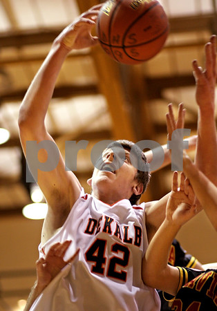 Beck Diefenbach  -  bdiefenbach@daily-chronicle.com<br /> <br /> DeKalb's Jordan Threloff (25) grabs a rebound during the first quarter of the game at DeKalb High School in DeKalb, Ill., on Tuesday Jan. 26, 2010. DeKalb defeated Batavia 68 to 65 in overtime.