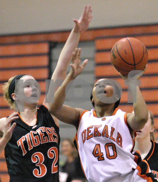 Kyle Bursaw – kbursaw@daily-chronicle.com<br /> <br /> DeKalb's Courtney Patrick goes for a shot against the defense of Hannah Credille. The DeKalb girls fell to the Wheaton Warrenville South Tigers 33-37 at Naperville North High School in Naperville, Ill. on Thursday, Dec. 23, 2010.