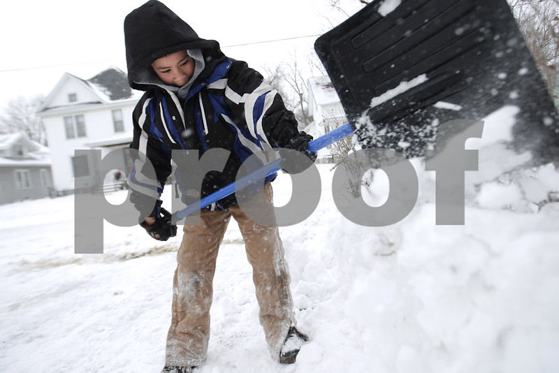 Kyle Bursaw – kbursaw@daily-chronicle.com<br /> <br /> Miguel Rosas, 8, shovels his family's driveway in DeKalb, Ill. on Sunday, Dec. 12, 2010.