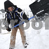 Kyle Bursaw – kbursaw@daily-chronicle.com<br /> <br /> Miguel Rosas, 8, shovels his family's driveway in DeKalb, Ill. on Sunday, Dec. 12, 2010.