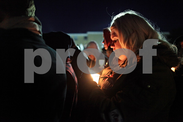 Beck Diefenbach  -  bdiefenbach@daily-chronicle.com<br /> <br /> Northern Illinois junior Ashley Harrah pauses with her candle during a collective moment of silence as part of the candlelight vigil at the Martin Luther King Commons on the campus of NIU in DeKalb, Ill., on Sunday Feb. 14, 2010.