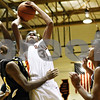 Rob Winner – rwinner@daily-chronicle.com<br /> <br /> Hinsdale South forward Chris Chacko (left) defends DeKalb center Andre Harris during a shot in the second quarter of their game at the Chuck Dayton Holiday Tournament in DeKalb on Wednesday night. Hinsdale South forward Brock Benson (right) converges on the play.