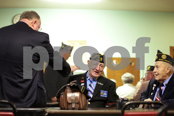 Beck Diefenbach  -  bdiefenbach@daily-chronicle.com<br /> <br /> Far left, Kenneth Fredin, pats the shoulder of Larry Geesey (center) of the American Legion's 13th District during a membership luncheon at American Legion Post 99 in Sycamore, Ill., on Friday Jan. 22, 2010.
