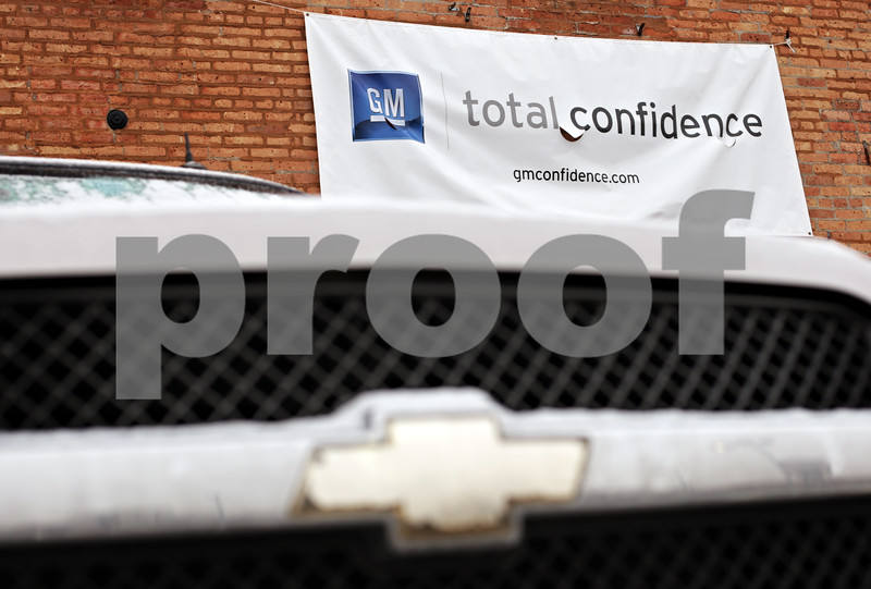 """Beck Diefenbach  -  bdiefenbach@daily-chronicle.com<br /> <br /> A banner expressing """"total confidence"""" hangs above a Chevrolet SUV at Mike Mooney Chevrolet-GMC-Cadillac in DeKalb, Ill., on Monday on Feb. 8, 2010."""