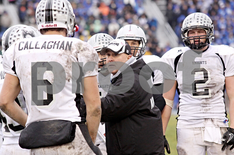 Wendy Kemp - For The Chronicle<br /> <br /> Assistant coach Joe Thorgesen talks with the Kaneland players during Saturday's playoff game against Vernon Hills High School.