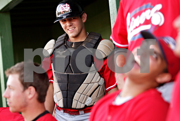 Beck Diefenbach  -  bdiefenbach@daily-chronicle.com<br /> <br /> DeKalb Liners catcher Anthony Foulk hangs out with teammates before their game at Founders Field at Sycamore Park on Friday July 2, 2010.