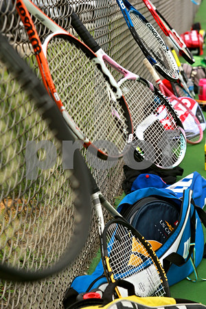Beck Diefenbach - bdiefenbach@daily-chronicle.com<br /> <br /> Rackets hang on the fence during girls' tennis practice at Sycamore High School in Sycamore, Ill., on Tuesday Aug. 17, 2010.