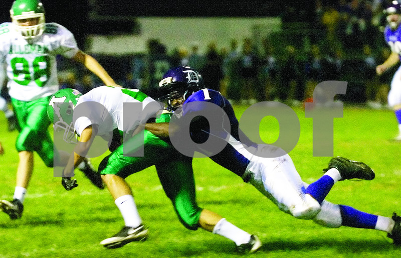 Philip Marruffo/pmarruffo@svnmai<br /> <br /> Dixon's Ricky Laskowski brings down a Rock Island Alleman ball carrier.