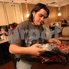 Wendy Kemp - For The Daily Chronicle<br /> Lucas Wakefield, of DeKalb, opens his gift after enjoying the complimentary holiday dinner at Flippin' Eggs in DeKalb on Thursday.<br /> DeKalb 12/23/10