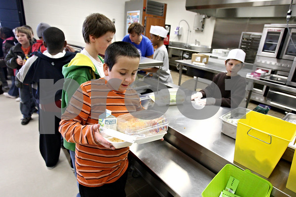 Rob Winner – rwinner@daily-chronicle.com<br /> Christian Rubio, 8, carefully balances his tray of salad, pears and milk during lunch at Cortland Elementary School in Cortland, Ill. on Friday February 19, 2010.
