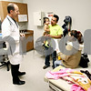 Rob Winner – rwinner@daily-chronicle.com<br /> <br /> Community Cares Clinic physician assistant David Wester talks with Melencio Garcia and Evencia Aguiree after examining their 1-year-old daughter Jennifer Garcia on Friday October 22, 2010 in DeKalb, Ill.