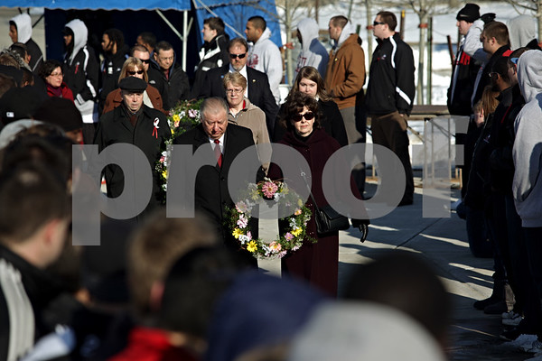 Beck Diefenbach – bdiefenbach@daily-chronicle.com<br /> <br /> Marking the two year anniversary of the shootings, Northern Illinois University President John Peters leads the procession to the wreath laying at the memorial on NIU's campus in DeKalb, Ill., on Sunday Feb. 14, 2010.