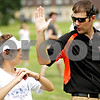 Beck Diefenbach  -  bdiefenbach@daily-chronicle.com<br /> <br /> Band director Steve Lundin guides sophomore Angelo Sarone during DeKalb High School's band camp at Clinton Rosette Middle School in DeKalb, Ill., on Monday August 2, 2010.