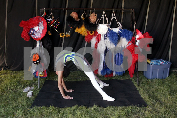 Beck Diefenbach - bdiefenbach@daily-chronicle.com<br /> <br /> Contortionist Kevin Sadrak stretches before performing at the Carson and Barnes Circus at the Sycamore Speedway in Sycamore, Ill., on Monday August 9, 2010.