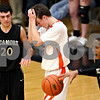 Beck Diefenbach - bdiefenbach@daily-chronicle.com<br /> <br /> DeKalb's Brian Sisler (22, center) reacts after he is called for fouling Sycamore's Sam Ford (25, right) during the fourth quarter of the IHSA Class 3A regional semifinal game against Sycamore at Kaneland High School in Maple Park, Ill., on Tuesday March 2, 2010.
