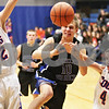 Rob Winner – rwinner@daily-chronicle.com<br /> <br /> Hinckley-Big Rock's Billy Weissinger (10) is fouled by Genoa-Kingston's Bret Lucca in the second quarter in Genoa on Monday night. Genoa-Kingston went on to defeat Hinckley-Big Rock, 72-51.