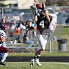 Beck Diefenbach  -  bdiefenbach@daily-chronicle.com<br /> <br /> Sycamore wide receiver CJ Compher (4) completes a pass for a touchdown during the second quarter of the game against Wheaton Academy at Sycamore High School in Sycamore, Ill., on Saturday Nov. 7, 2009. Sycamore defeated Wheaton Academy 42 to 0.
