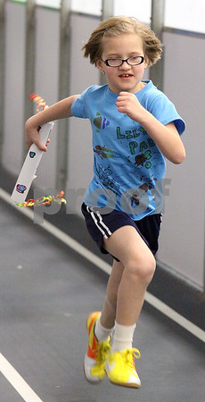 Wendy Kemp/For The Chronicle<br /> Ally Belick, 7, of Genoa runs during the mini-relay marathon at the Kishwaukee YMCA on Saturday.<br /> Sycamore 4/18/10