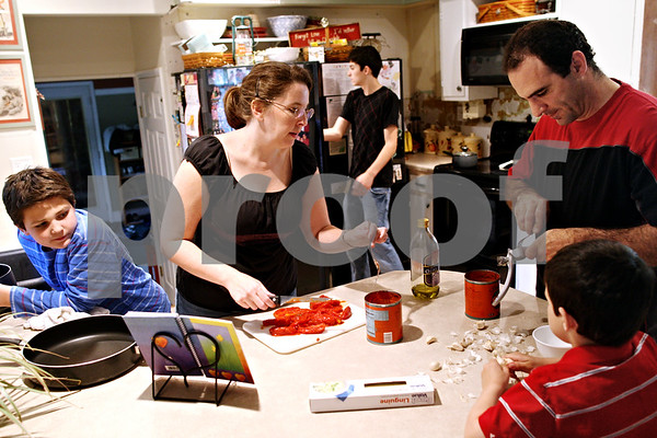 Beck Diefenbach  -  bdiefenbach@daily-chronicle.com<br /> <br /> The Ladas family makes dinner together at their home in Sycamore, Ill., on Thursday May 6, 2010. Parents Julianna (second from left) and Tony (top right) get help making spaghetti from their three boys Brennan (far left), 10, Nicholas (back), 14, and Kaden (bottom right), 5.