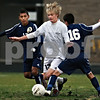 Kyle Bursaw - kbursaw@daily-chronicle.com<br /> <br /> Kaneland's Sam Rymarz squeezes between Sterling's Pedro Ocampo and Conrado Solis. The Knights lost in triple overtime to Sterling 3-2