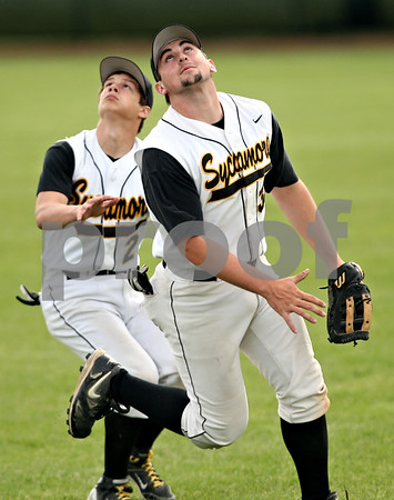 Beck Diefenbach  -  bdiefenbach@daily-chronicle.com<br /> <br /> Sycamore Zack Spiewak (2, left) and Adam Dobson (32, right) track a foul ball but are unable to make the out during the first inning of the game against Kaneland at Kishwuakee College in Malta, Ill., on Friday May 14, 2010.