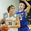 Rob Winner – rwinner@daily-chronicle.com<br /> <br /> Sycamore's Tom Paulson drives to the basket past Burlington Central's Jared Moxness during the second quarter in Sycamore on Wednesday night.