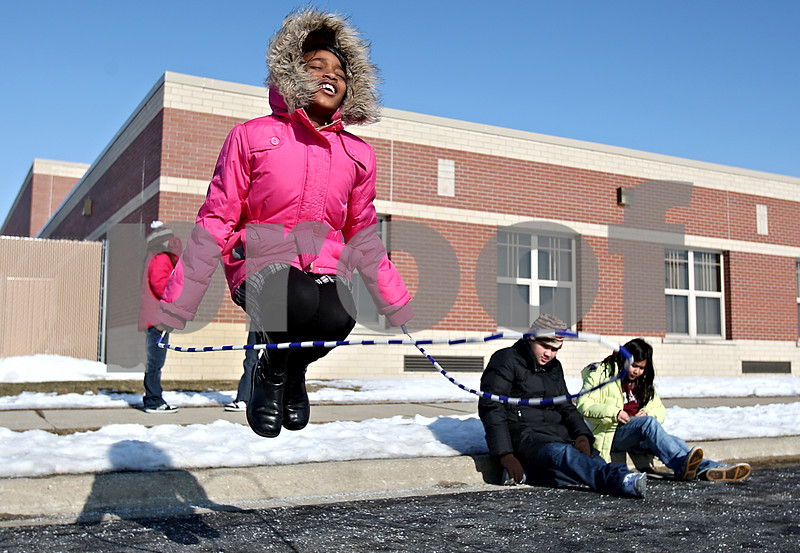 Rob Winner – rwinner@daily-chronicle.com<br /> Third grader Destiny Jones, 8, spends her lunch recess jumping rope at Gwendolyn Brooks Elementary School in DeKalb, Ill. on Tuesday January 19, 2010.