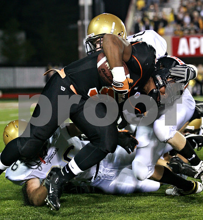 Beck Diefenbach – bdiefenbach@daily-chronicle.com<br /> <br /> DeKalb running back Spencer Blank-Jones (5, center) is taken down by Sycamore defensive back Tim Hall (40) during the first quarter of the Castle Challenge football game between DeKalb and Sycamore High Schools at Huskie Stadium on the campus of Northern Illinois University in DeKalb, Ill., on Friday Sept. 10 2010.