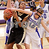Beck Diefenbach  -  bdiefenbach@daily-chronicle.com<br /> <br /> Sycamore's Montia Johnson (32) keeps the ball away from Burlington Central's Katie McNutt (12) during the second half of the IHSA Class 3A Regional playoff game at Rochelle Township High School in Rochelle, Ill, on Monday Feb. 15, 2010.