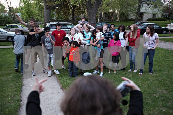 Beck Diefenbach – bdiefenbach@daily-chornicle.com<br /> <br /> Extended family and neighbors of the Ballantine family surround Kevin (center) for a group photo during a barbeque at Kevin's home on March 17, 2009. The BBQ was a send-off for Kevin before he checked into a Chicago hospital for his bone marrow transplant.