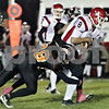 Wendy Kemp - For The Daily Chronicle<br /> DeKalb's Jake Gordon tackles Yorkville's Brant Corwin during Friday's game.<br /> DeKalb 10/15/10