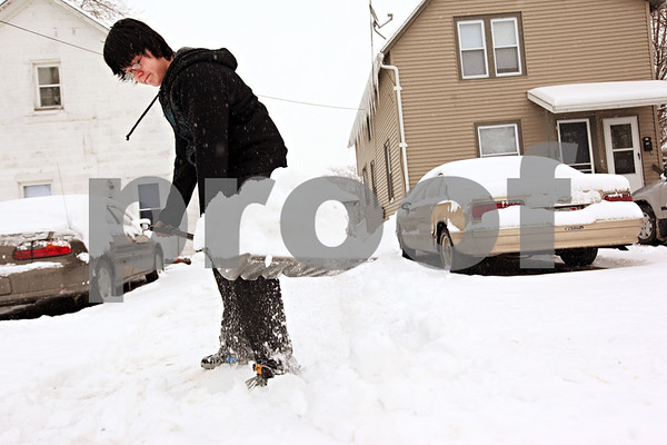 Beck Diefenbach  -  bdiefenbach@daily-chronicle.com<br /> <br /> Jake Davis, 14, of Sycamore, shovels the snow in his home's driveway on Thursday Jan. 7, 2009. Davis' school, Sycamore High School, was cancelled due to the snow fall.
