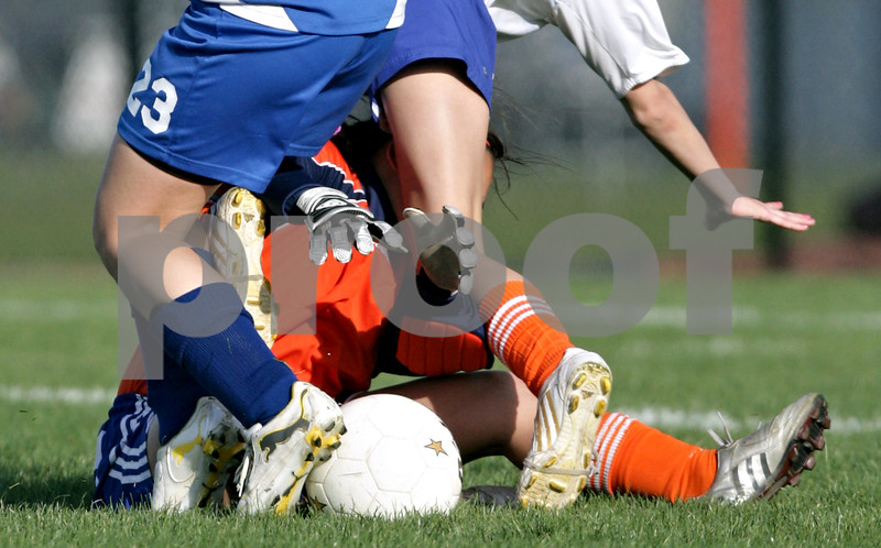 Beck Diefenbach  -  bdiefenbach@daily-chronicle.com<br /> <br /> Hinckley-Big Rock's Sarah Paver (23, top left) and Genoa-Kingston's Lauren Orozco (2, top right) trip over G-K goalie Nicole Crozier during the second half of the game at G-K in Genoa, Ill., on Monday april 26, 2010. H-BR defeated G-K 5 to 1.