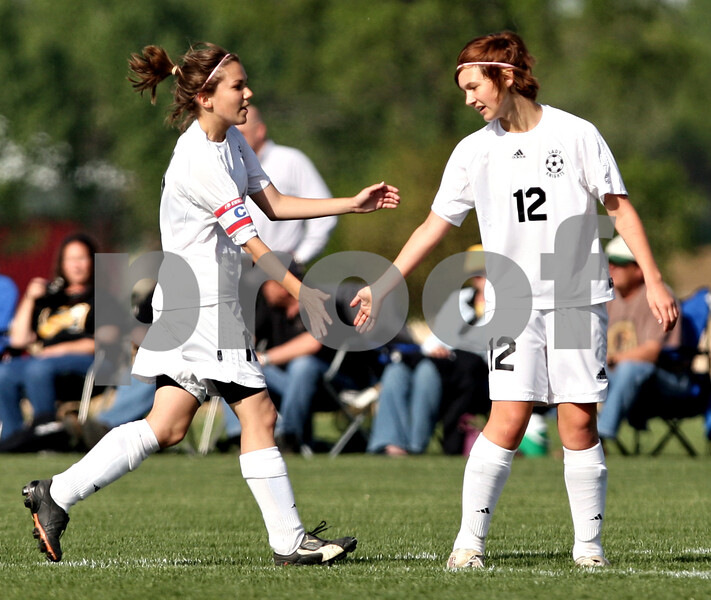 Beck Diefenbach  -  bdiefenbach@daily-chronicle.com<br /> <br /> Kaneland's Haley Johnson (11, left) congratulates Sophia Blank (12) following her goal during the first half of the game against Sycamore at Kaneland High School in Maple Park, Ill., on Thursday May 6, 2010. Kaneland defeated Sycamore 1 to 0.