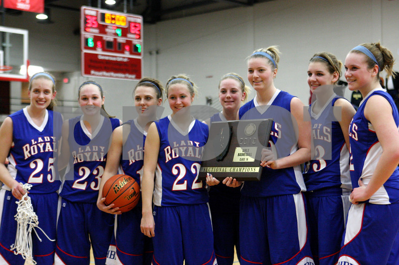 Rob Winner – rwinner@daily-chronicle.com<br /> Hinckley-Big Rock celebrates their sectional victory after defeating Elgin Academy, 62-35, on Thursday night at Mooseheart.