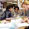Beck Diefenbach  -  bdiefenbach@daily-chronicle.com<br /> <br /> DeKalb freshman Marquita Seals (center) gets help with her Algebra homework from Northern Illinois University student teacher Stefanie Gutierrez during the Student Tutors and Resources program at DeKalb High School on Wednesday Feb. 3, 2010.