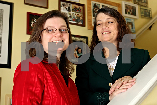 Rob Winner – rwinner@daily-chronicle.com<br /> Wendy Engles (right) is the team leader of the Catholics Returning Home campaign at St. Catherine of Genoa Catholic Church in Genoa, Ill. Wendy credits her husband and daughter, Jennifer Engles (left), for helping her return to her faith.