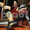 Beck Diefenbach  -  bdiefenbach@daily-chronicle.com<br /> <br /> DeKalb's Danny Wilson is hit in the mouth by the foot of Sandwich's Lon McCaslin during the 135 pound match at DeKalb High School in DeKalb, Ill., on Thursday Jan. 28, 2010. Wilson lost to McCaslin, but DeKalb was able to come back and defeat Sandwich 37 to 27.