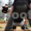 Beck Diefenbach  -  bdiefenbach@daily-chronicle.com<br /> <br /> DeKalb pitcher Ben Dallesasse (15) throws the ball during the bottom of the second inning of the game against Sycamore at Sycamore Park in Sycamore, Ill., on Tuesday April 6, 2010.